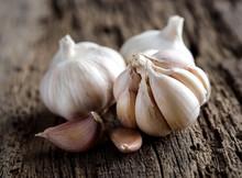 Garlic Cloves On Wooden Vintag...