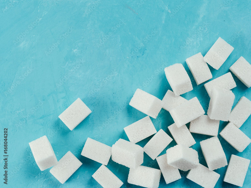 Fototapety, obrazy: sugar cubes on blue concrete background. Top view of white sugar on turquoise table. Sugar with copy space. Top view or flat lay