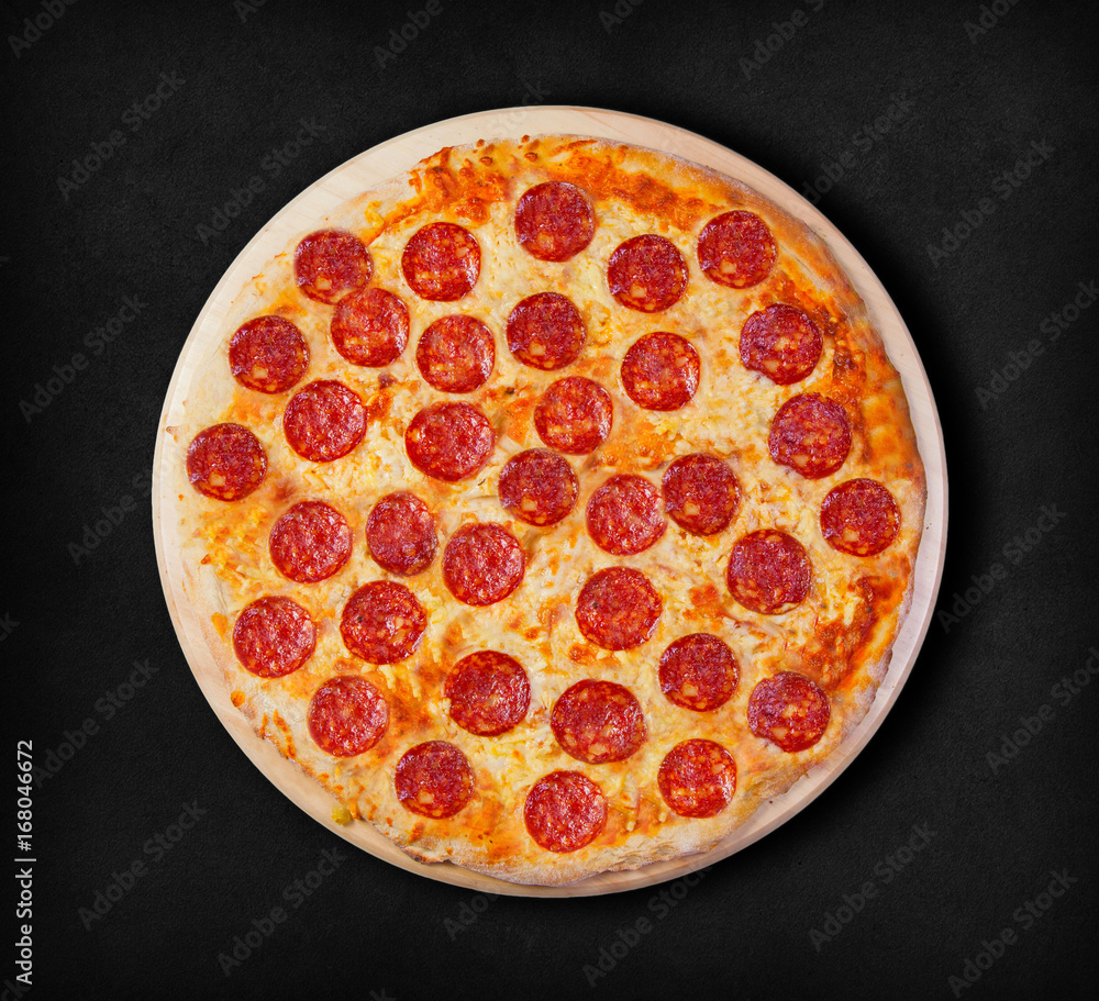 Pepperoni pizza on a black background. Visit my page. You will be able to find an image for every pizza sold in your cafe or restaurant