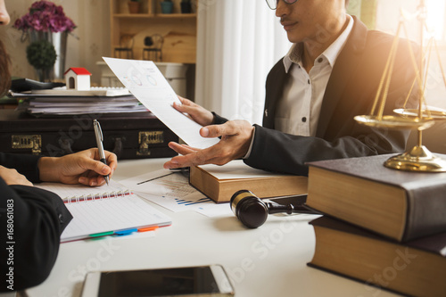 Fotografie, Obraz  The hard work of an asian lawyer in a lawyer's office