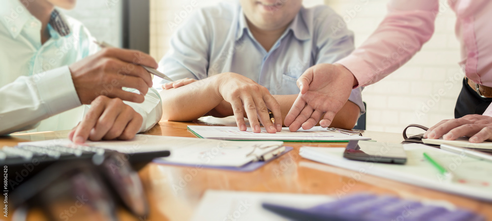 Fototapeta Business meetings with government and private borrowers with co-workers and a tax advisor to assign roles of employees in the organization of each agency.