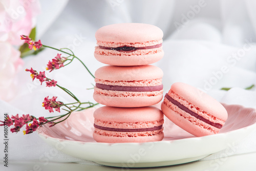 Poster Dessert Pink strawberry macarons. French delicate dessert for Breakfast