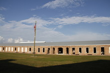 Barracks At Fort Zachary Taylor With The United States Flag In Foreground