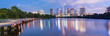 canvas print picture - Panorama view of Downtown Austin, Texas, USA skylines reflection on the Colorado River at twilight. View from Ann and Roy Butler Hike-and-Bike Trail and boardwalk at Lady Bird Lake is on the left.