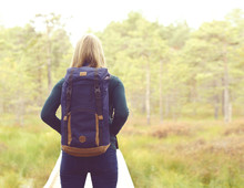 Happy, Beautiful Blond Girl Walking In Forest And Swamps. Camp, Tourism, Hiking Concept.