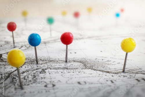 Pin marking location on map. Adventure and travel theme grunge background.