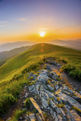 FototapetaSunset in the mountains