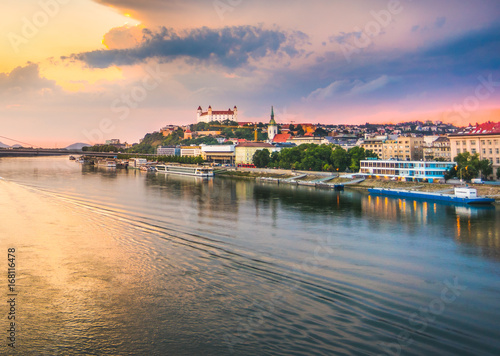 Photo  Cityscape of Bratislava, Slovakia at Sunset  as Seen from a Bridge over Danube River Towards Old Town of Bratislava