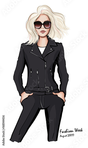 Tuinposter Art Studio Attractive woman wearing leather jacket and sunglasses