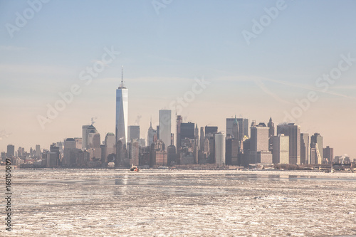 Fotografie, Tablou  Frozen NYC Skyline; Rare Ice-covered Hudson River; Winter Polar Vortex 2015; Cli