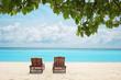 Sun loungers on beach at sea resort