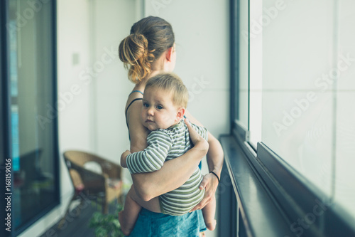 Mother with baby on balcony in the city Canvas Print
