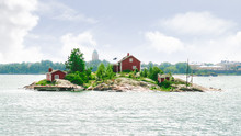A Small Island With A House With The Helsinki Skyline Visible In The Background. Taken Near Suomenlinna, Finland