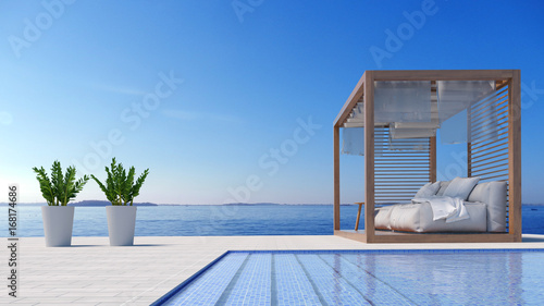 Fotografia Beach lounge - Sundeck on Sea view for vacation and summer in swimming pool / 3d