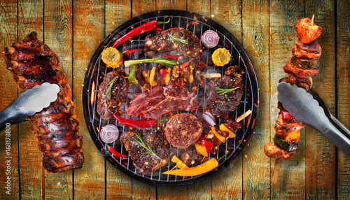 Aluminium Prints Grill / Barbecue Top view of fresh meat and vegetable on grill placed on wooden planks