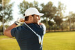 Close up of a young concentrated man shooting golf ball