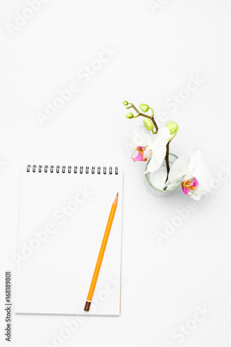 Open notebook with pencil and Flowers orchid Poster