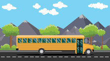 School Bus Yellow On Road With Tree And Mountain As Background