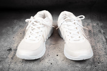 Pair Of White Sports Shoes