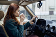 Caucasian woman driving car and drinking coffee
