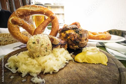 Photo south tyrol food pork shank canederli kraut sausage