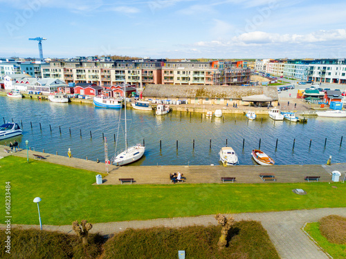 Aerial view of the canal with boats docked by the river bank Wallpaper Mural