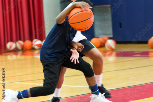 Dribbling a basketball at summer camp