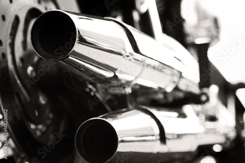 Motorcycle with chrome ports low angle photograph with close-up on exhaust Canvas