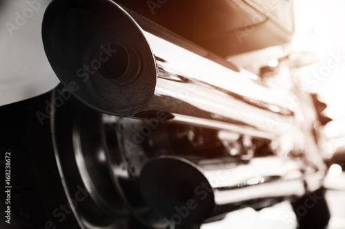 Motorcycle with chrome ports low angle photograph with close-up on exhaust Poster