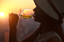 Girl Drinking White Wine At The Sunset In Paris City