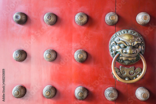 Photo  Chinatown traditional red wooden door guardian brass handle