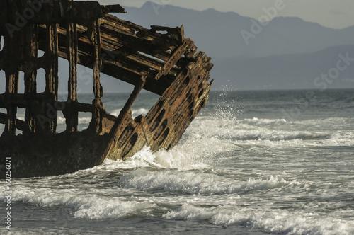 Shipwreck Ocean crashing on Skeleton of Ship Wreck