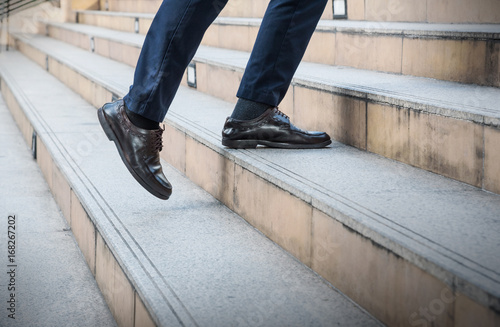 traveling man in leather black shoes