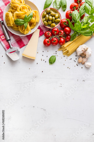 Fotografiet  Italian food cuisine and ingredients on white concrete table