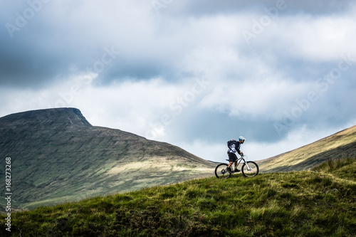 Mountain biking in the Brecon Beacons - lone rider against an epic view Canvas Print