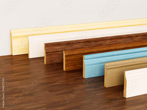Photo Baseboards with various profiles standing on hardwood surface