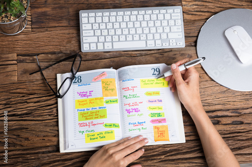 Photo  Businessperson Writing Schedule In Diary
