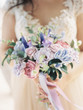 canvas print picture - wedding bouquet in a brides hands