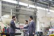 Business people shaking hands in the factory