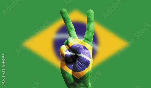 Garden Poster Brazil Brazil national flag painted onto a male hand showing a victory, peace, strength sign