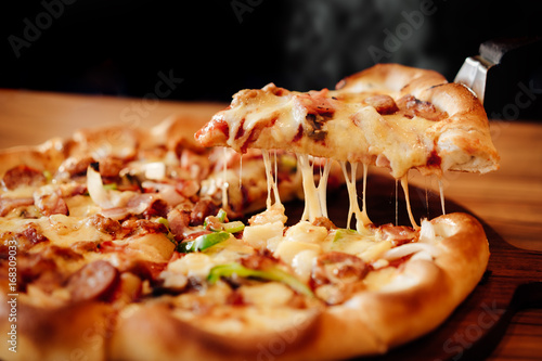 Hot pizza cheese crust seafood topping sauce vegetables delicious fast food Fototapeta