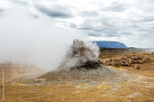 Fototapety, obrazy: Mudpot in the Namafjall geothermal area, Iceland - area around boiling mud is multicolored and cracked