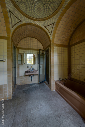 Vintage Brown And Yellow Tiled Bathroom With Fixtures