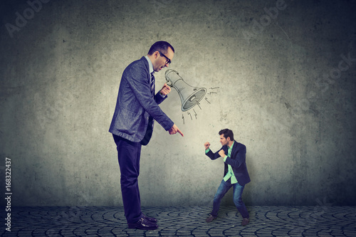 Fotografie, Obraz  Man fighting against his big angry boss