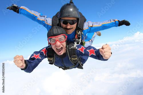 Fotografie, Obraz  Skydiving. Tandem jump. Happy Passenger.