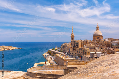 Poster de jardin Europe Méditérranéenne View from above of the domes of churches and roofs with church of Our Lady of Mount Carmel and St. Paul's Anglican Pro-Cathedral, Valletta, Capital city of Malta