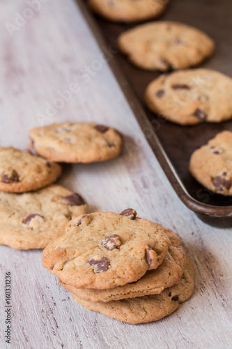 Tuinposter Koekjes Chocolate Chip Cookies In A Row and On Cookie Sheet