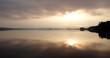 Sunrise on the lake. Cloud and dusk. Panoramic image. Amazing reflections.