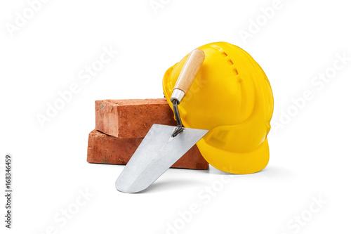 Fotografía Trowel, bricks and helmet