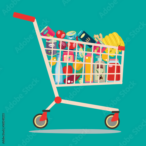 Fotografía  Shopping cart full of groceries products.